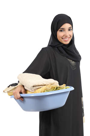 household tasks: Beautiful arab woman carrying laundry isolated on a white