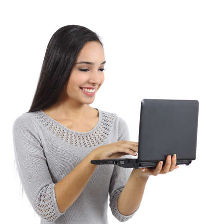 Beautiful woman browsing internet on a notebook computer isolated on a white background               photo
