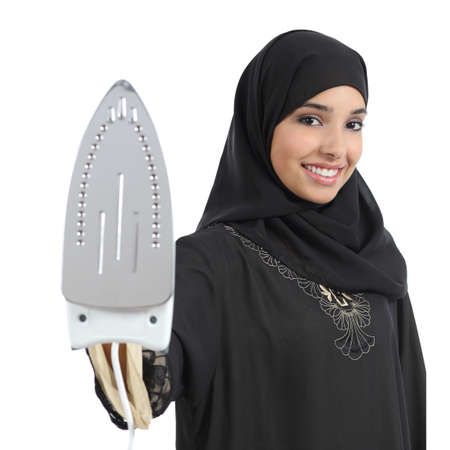 domestic task: Arab housewife woman smiling and holding a smoothing iron isolated on a white background
