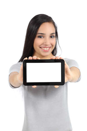 Pretty woman showing a blank horizontal tablet screen isolated on a white background            photo