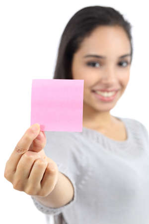sticky hands: Beautiful woman showing a blank pink paper note isolated on a white background Stock Photo
