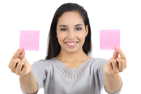 both: Woman showing two paper notes isolated on a white background