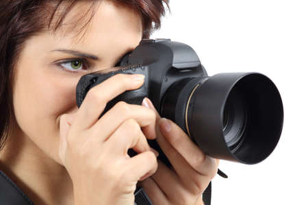 Beautiful photographer woman holding a digital camera isolated on a white background              photo