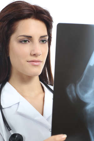 Beautiful doctor woman looking a radiography of a knee isolated on a white background photo