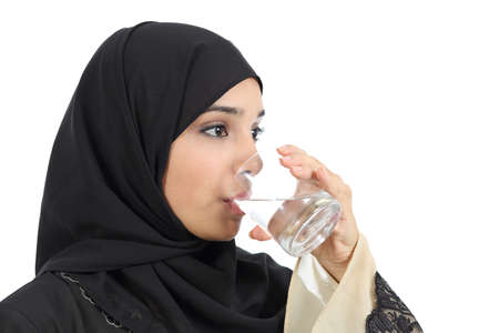 Arab woman drinking water from a glass isolated on a white background photo
