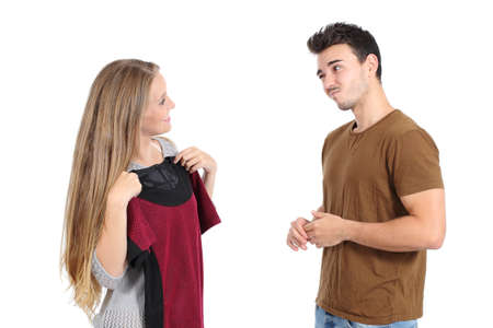 Happy woman trying clothes shopping with her boyfriend and asking for advice isolated on a white background photo