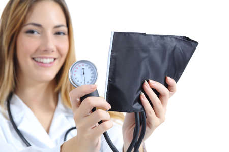 controling: Female doctor holding and showing a sphygmomanometer isolated on a white background