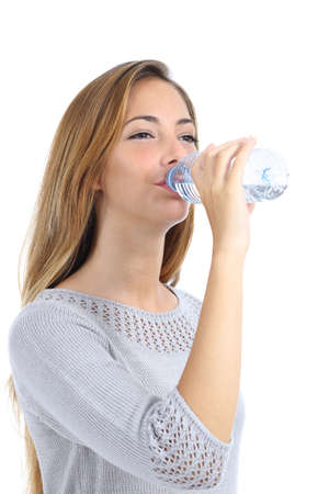 hand water: Beautiful woman drinking water from a bottle isolated on a white background             Stock Photo