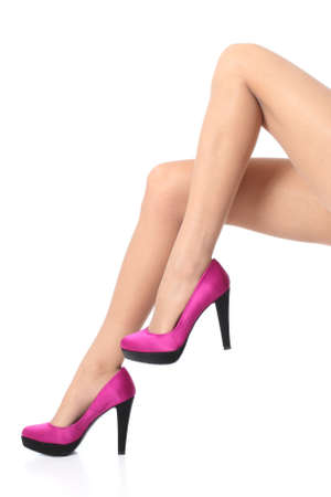 seducing: Beautiful woman legs wearing a high stiletto heels isolated on a white background