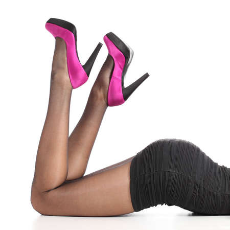 Beautiful woman legs with black stockings and high heels isolated on a white background photo