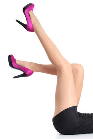 Beautiful woman legs with fuchsia high heels  and tights pointing up isolated on a white background           Stock Photo