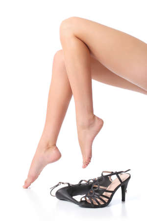 waxed legs: Beautiful woman smooth and waxed legs and feet with a heels beside isolated on a white background