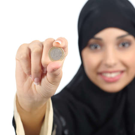 give charity: Arab woman holding and showing an euro coin isolated on a white background