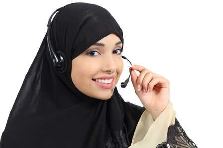 Beautiful phone operator arab woman working isolated on a white background     photo
