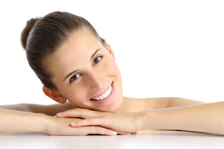 perfect smile: Portrait of a beautiful natural woman facial with a white perfect smile isolated on a white background                  Stock Photo