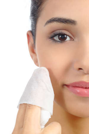 wipe: Close up of a woman face removing make up with a baby wipe isolated on a white background