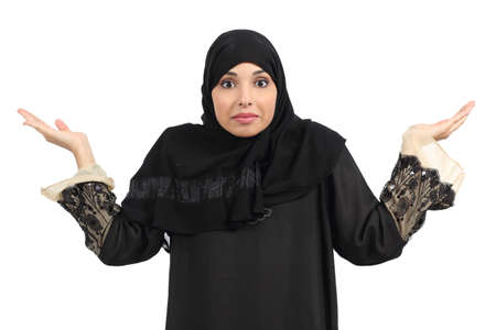 incertitude: Arab woman doubting and gesturing isolated on a white background