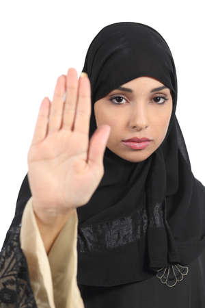 banning the symbol: Arab woman making stop gesture with her hand isolated on a white background