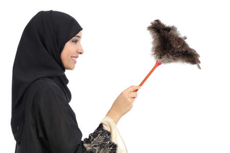 Profile of an arab woman cleaning with a duster clean isolated on a white background photo
