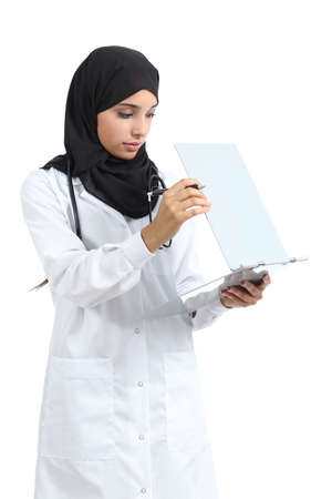 Arab doctor woman reading a clinical history isolated on a white background photo