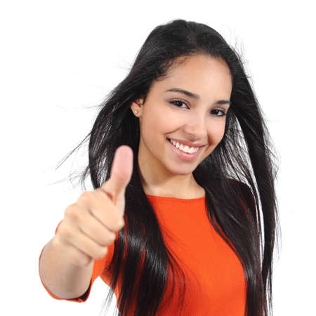 Beautiful woman with perfect white smile with thumb up isolated on a white background photo