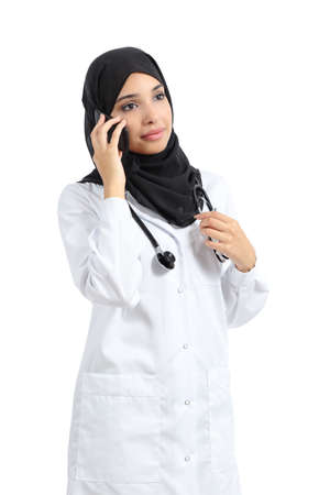 Arab doctor woman talking on the smart phone isolated on a white background                 photo