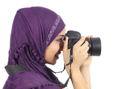 Arab woman photographer holding a dslr camera isolated on a white background        photo