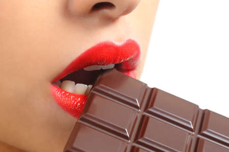 Beautiful woman red lips eating chocolate isolated on a white background