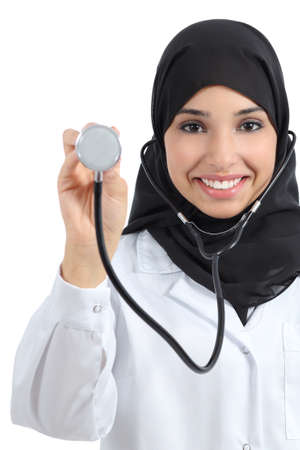 Front view of an arab doctor woman showing stethoscope isolated on a white background           photo