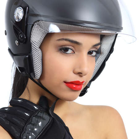 Sexy biker woman with an helmet and gloves isolated on a white background              photo