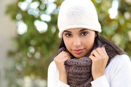 warmly: Facial portrait of a beautiful arab woman warmly clothed outdoor Stock Photo