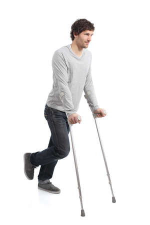 lame: Rehabilitation of an adult man walking with crutches isolated on a white background