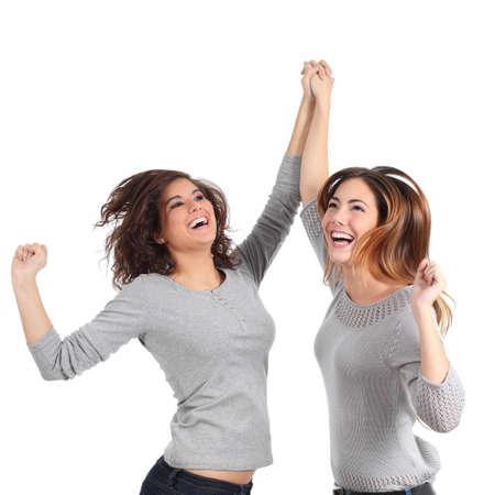 euphoric: Due ragazze euforici saltando isolato su uno sfondo bianco