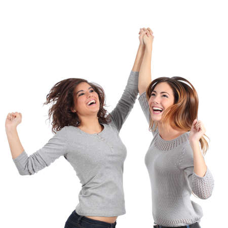 Two euphoric girls jumping isolated on a white background