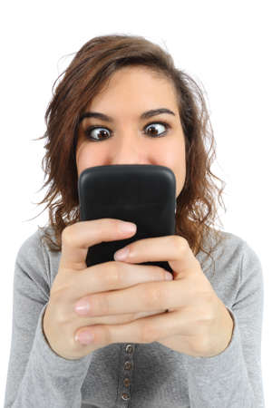 Close up of a teenager addicted to the smart phone isolated on a white background Stock Photo