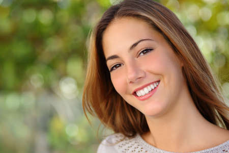 Beautiful white woman smile dental care concept with a green background photo
