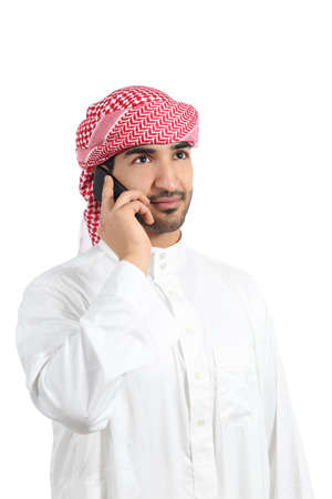 Arab man talking on the smart phone isolated on a white background             photo