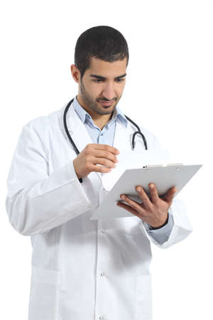 arab: Arab doctor man reading a medical history isolated on a white background