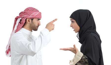 middle east fighting: Arab couple discussing angry isolated on a white background                Stock Photo
