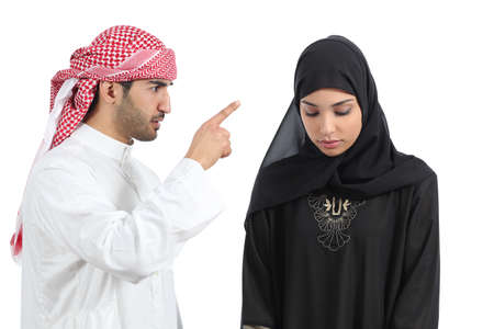 Arab couple with a man arguing to his wife isolated on a white background