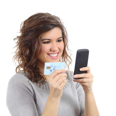 Beautiful woman holding a credit card buying on the smart phone isolated on a white background            photo