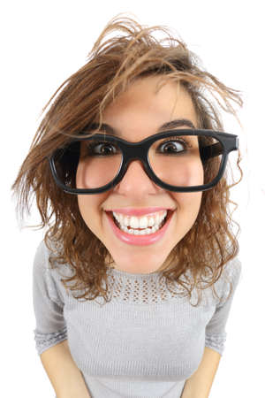 Wide angle view of a geek woman with glasses smiling isolated on a white background           Фото со стока