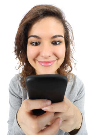 obsession: Wide angle view of a pretty teenager girl happy with a smart phone isolated on a white background