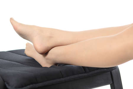 stocking feet: Close up of a tired woman legs resting isolated on a white background Stock Photo