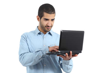 Arab casual man browsing a laptop social media isolated on a white background photo