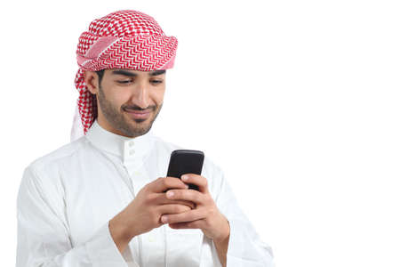 Arab saudi man watching social media in the smart phone isolated on a white background             photo