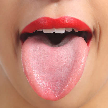 Close up of a front view of a woman tongue and red painted lips