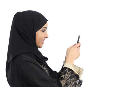 Profile of an arab saudi woman using a smart phone isolated on a white background photo
