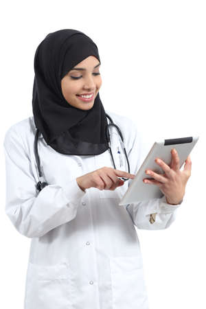 Saudi arab doctor woman working with a tablet isolated on a white background                photo