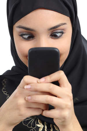 Arab woman addicted to the smartphone isolated on a white background photo